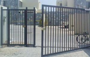 Portón batiente 1 Hoja con puerta peatonal